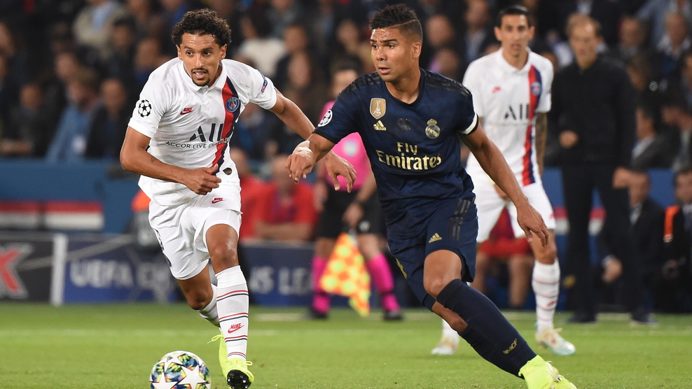 Paris Saint-Germain's Brazilian defender Marquinhos (L) vies Real Madrid's Brazilian midfielder Casemiro during the UEFA Champions league Group A football match between Paris Saint-Germain and Real Madrid, at the Parc des Princes stadium, in Paris, on September 18, 2019. (Photo by Lucas BARIOULET / AFP)        (Photo credit should read LUCAS BARIOULET/AFP/Getty Images)